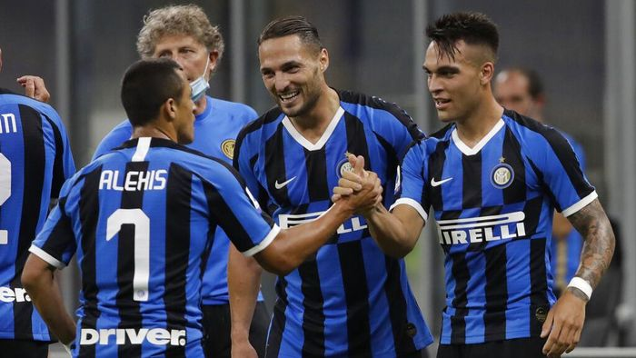 Inter Milans Lautaro Martinez, right, celebrates after scoring his sides third goal during a Serie A soccer match between Inter Milan and Torino, at the San Siro stadium in Milan, Italy, Monday, July 13, 2020. (AP Photo/Luca Bruno