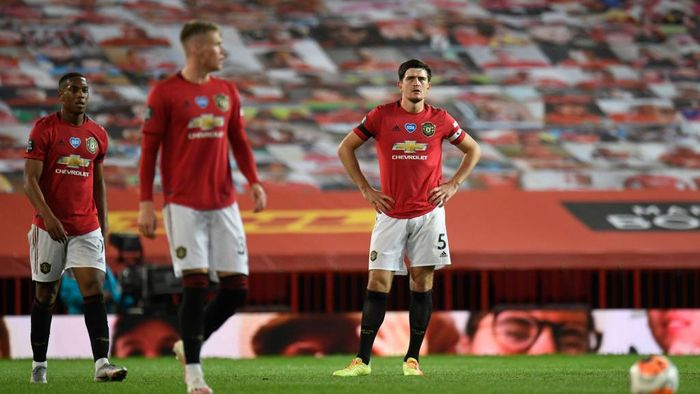 MANCHESTER, ENGLAND - JULY 13: Harry Maguire of Manchester United looks dejected during the Premier League match between Manchester United and Southampton FC at Old Trafford on July 13, 2020 in Manchester, England. Football Stadiums around Europe remain empty due to the Coronavirus Pandemic as Government social distancing laws prohibit fans inside venues resulting in all fixtures being played behind closed doors. (Photo by Peter Powell/Pool via Getty Images)