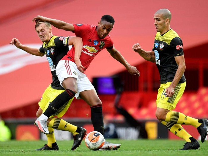 MANCHESTER, ENGLAND - JULY 13: Anthony Martial of Manchester United battles for possession with James Ward-Prowse and Oriol Romeu of Southampton during the Premier League match between Manchester United and Southampton FC at Old Trafford on July 13, 2020 in Manchester, England. Football Stadiums around Europe remain empty due to the Coronavirus Pandemic as Government social distancing laws prohibit fans inside venues resulting in all fixtures being played behind closed doors. (Photo by Peter Powell/Pool via Getty Images)