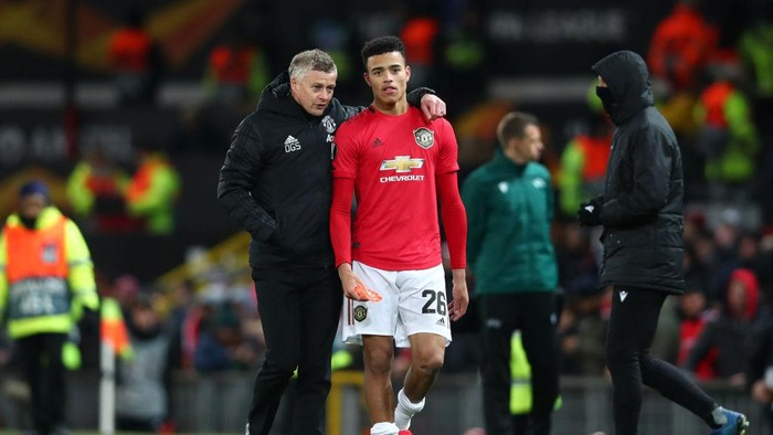 MANCHESTER, ENGLAND - FEBRUARY 27: Ole Gunnar Solskjaer, Manager of Manchester United speaks to Mason Greenwood of Manchester United following their sides victory in the UEFA Europa League round of 32 second leg match between Manchester United and Club Brugge at Old Trafford on February 27, 2020 in Manchester, United Kingdom. (Photo by Clive Brunskill/Getty Images)