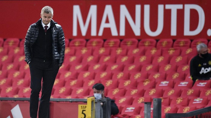 Manchester Uniteds manager Ole Gunnar Solskjaer reacts after the English Premier League soccer match between Manchester United and Southampton at Old Trafford in Manchester, England, Monday, July 13, 2020. (AP Photo/Peter Powell,Pool)