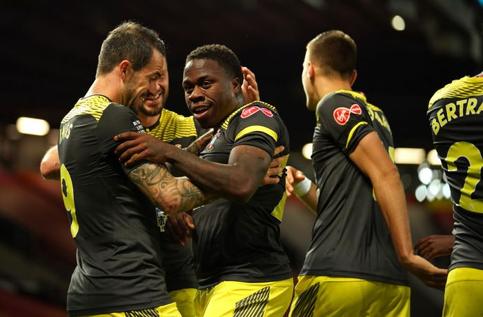 MANCHESTER, ENGLAND - JULY 13: Michael Obafemi of Southampton celebrates with teammates after scoring his teams second goal during the Premier League match between Manchester United and Southampton FC at Old Trafford on July 13, 2020 in Manchester, England. Football Stadiums around Europe remain empty due to the Coronavirus Pandemic as Government social distancing laws prohibit fans inside venues resulting in all fixtures being played behind closed doors. (Photo by Dave Thompson/Pool via Getty Images)
