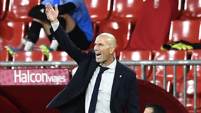 Real Madrids head coach Zinedine Zidane gestures during the Spanish La Liga soccer match between Granada and Real Madrid at the Los Carmenes stadium in Granada, Spain, Monday, July 13, 2020. (AP Photo/Jose Breton)