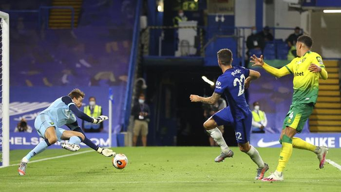 Norwich Citys goalkeeper Tim Krul, left, saves a shot from Chelseas Christian Pulisic, centre, during the English Premier League soccer match between Chelsea and Norwich City at Stamford Bridge in London, England, Tuesday, July 14, 2020. (AP Photo/Julian Finney,Pool)