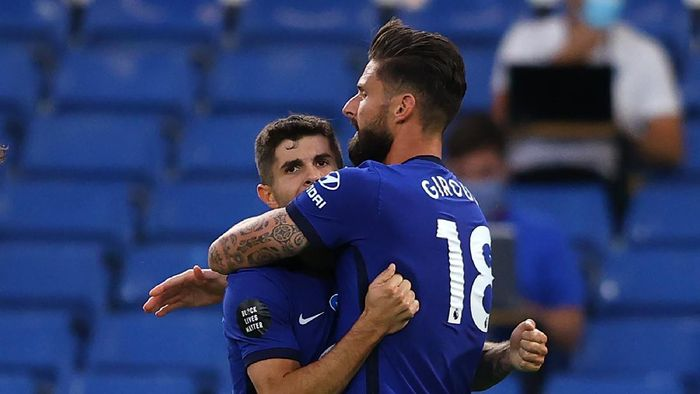 LONDON, ENGLAND - JULY 14: Olivier Giroud of Chelsea celebrates after scoring his sides first goal with Christian Pulisic  during the Premier League match between Chelsea FC and Norwich City at Stamford Bridge on July 14, 2020 in London, England. Football Stadiums around Europe remain empty due to the Coronavirus Pandemic as Government social distancing laws prohibit fans inside venues resulting in all fixtures being played behind closed doors. (Photo by Richard Heathcote/Getty Images)