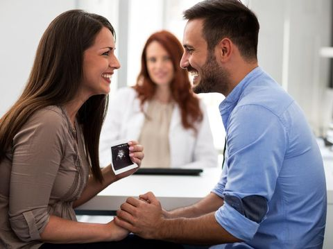 Doctor during consultation held in his hand and shows patient anatomical model of male sperm. Counseling of men and couples about male infertility, sperm pathology, impossibility to get pregnant