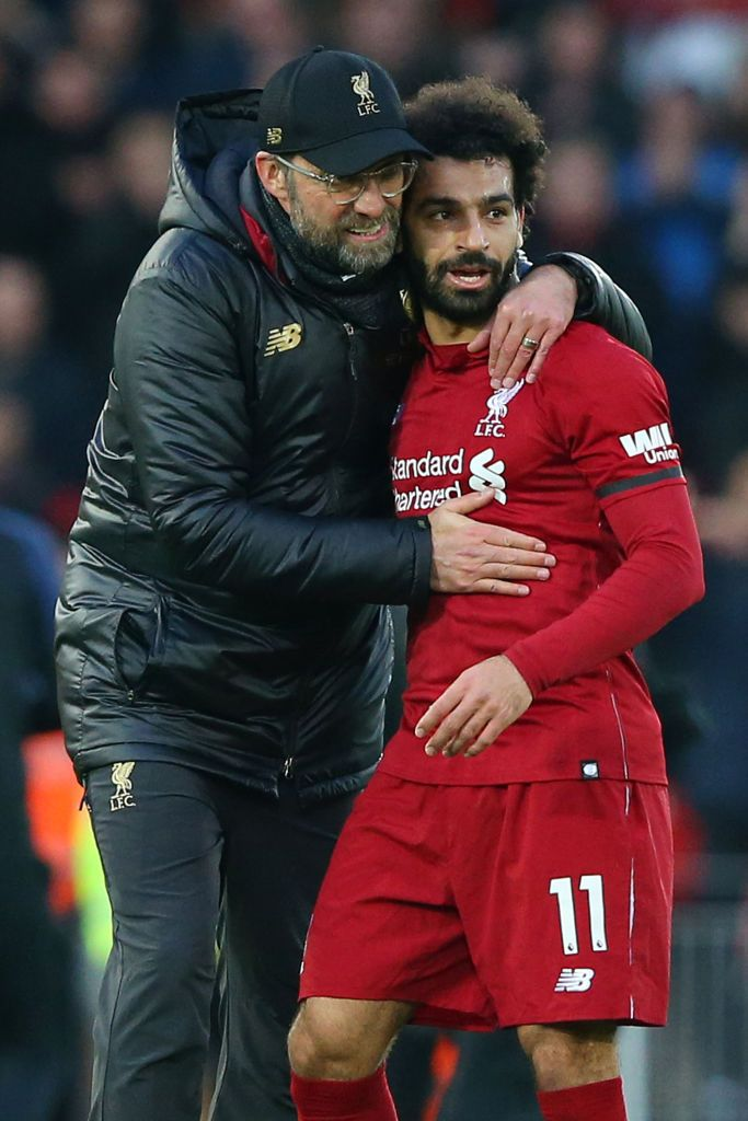 LIVERPOOL, ENGLAND - FEBRUARY 09: Jurgen Klopp, Manager of Liverpool celebrates victory with Mohamed Salah of Liverpool after the Premier League match between Liverpool FC and AFC Bournemouth at Anfield on February 9, 2019 in Liverpool, United Kingdom.  (Photo by Alex Livesey/Getty Images)