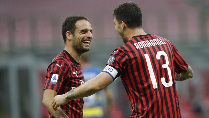 AC Milans Alessio Romagnoli, right, celebrates his goal with his teammate Giacomo Bonaventura, left, during a Serie A soccer match between AC Milan and Parma, at the San Siro stadium in Milan, Italy, Wednesday, July 15, 2020. (AP Photo/Luca Bruno)