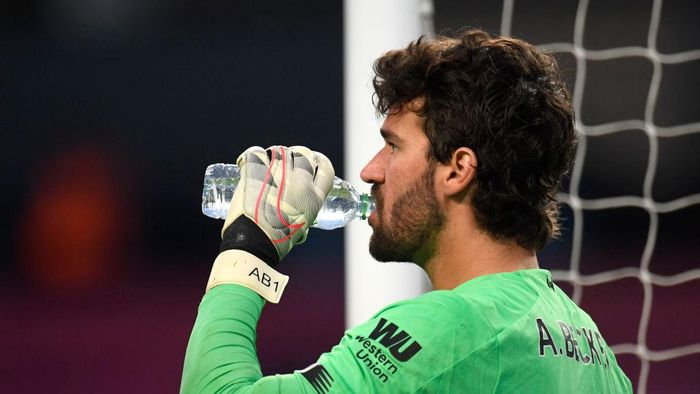 MANCHESTER, ENGLAND - JULY 02: Alisson Becker of Liverpool has a drink during the Premier League match between Manchester City and Liverpool FC at Etihad Stadium on July 02, 2020 in Manchester, England. Football Stadiums around Europe remain empty due to the Coronavirus Pandemic as Government social distancing laws prohibit fans inside venues resulting in all fixtures being played behind closed doors. (Photo by Peter Powell/Pool via Getty Images)