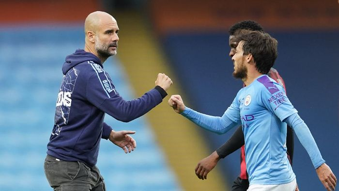 MANCHESTER, ENGLAND - JULY 15: Pep Guardiola, Manager of Manchester City interacts with David Silva of Manchester City after the Premier League match between Manchester City and AFC Bournemouth  at Etihad Stadium on July 15, 2020 in Manchester, England. Football Stadiums around Europe remain empty due to the Coronavirus Pandemic as Government social distancing laws prohibit fans inside venues resulting in all fixtures being played behind closed doors. (Photo by Dave Thompson/Pool via Getty Images)