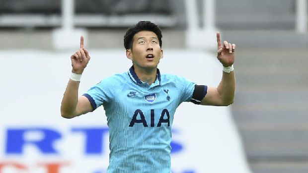 Tottenham's Son Heung-min celebrates after scoring his side's opening goal during the English Premier League soccer match between Newcastle United and Tottenham Hotspur at St. James' Park in Newcastle, England, Wednesday, July 15, 2020. (Stu Forster/Pool via AP)