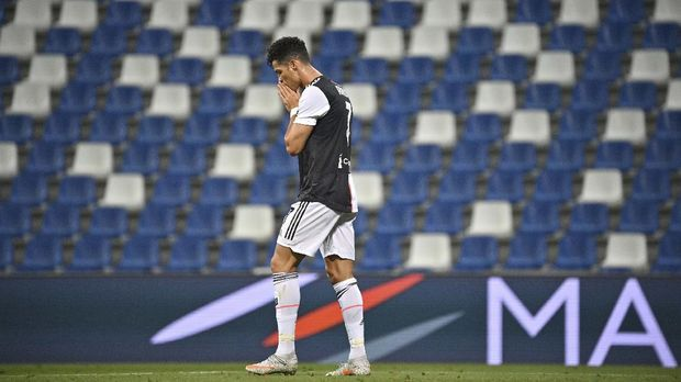 Juventus' Cristiano Ronaldo reacts during a Serie A soccer match between Sassuolo and Juventus at the Mapei Stadium in Reggio Emilia, Italy, Wednesday, July 15, 2020. (Massimo Paolone/LaPresse via AP)