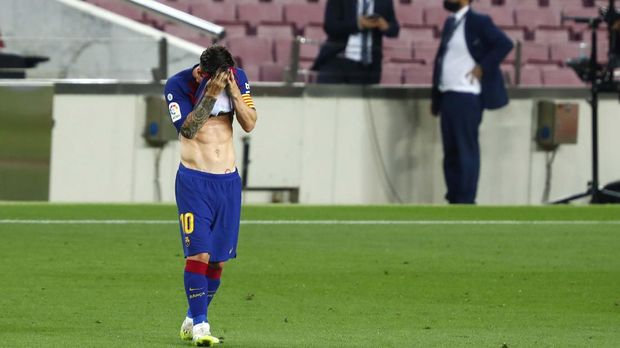 Barcelona's Lionel Messi reacts during a Spanish La Liga soccer match between Barcelona and Osasuna at the Camp Nou stadium in Barcelona, Spain, Thursday, July 16, 2020. (AP Photo/Joan Monfort)