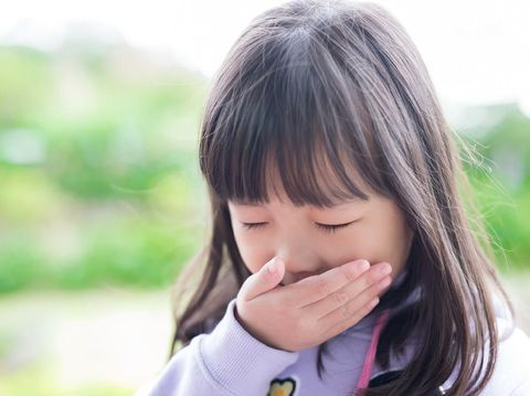 cute little girl get cold and feel vomit, asian
