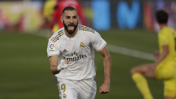 Real Madrids Karim Benzema celebrates after scoring during the Spanish La Liga soccer match between Real Madrid and Villareal at the Alfredo di Stefano stadium in Madrid, Spain, Thursday, July 16, 2020. (AP Photo/Bernat Armangue)