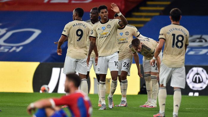 LONDON, ENGLAND - JULY 16: Marcus Rashford of Manchester United celebrates after scoring his sides first goal during the Premier League match between Crystal Palace and Manchester United at Selhurst Park on July 16, 2020 in London, England. Football Stadiums around Europe remain empty due to the Coronavirus Pandemic as Government social distancing laws prohibit fans inside venues resulting in all fixtures being played behind closed doors. (Photo by Glyn Kirk/Pool via Getty Images)
