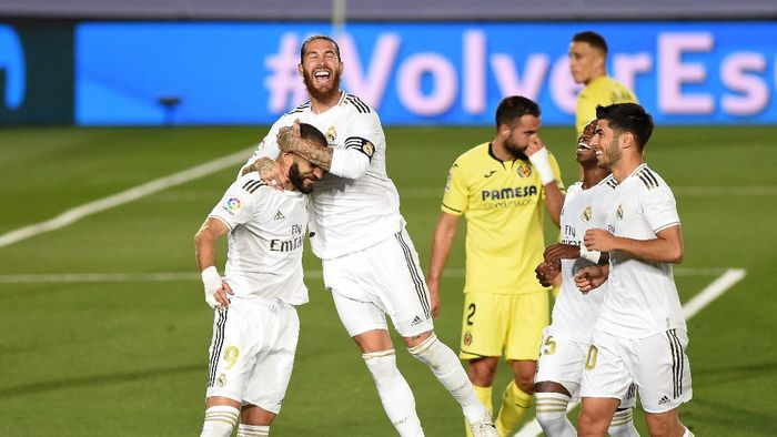 MADRID, SPAIN - JULY 16: Karim Benzema of Madrid celebrates scoring the second goal from a penalty during the Liga match between Real Madrid CF and Villarreal CF at Estadio Alfredo Di Stefano on July 16, 2020 in Madrid, Spain. (Photo by Denis Doyle/Getty Images)