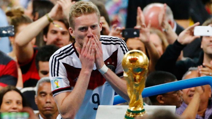 RIO DE JANEIRO, BRAZIL - JULY 13:  Andre Schuerrle of Germany looks at the World Cup trophy after defeating Argentina 1-0 in extra time during the 2014 FIFA World Cup Brazil Final match between Germany and Argentina at Maracana on July 13, 2014 in Rio de Janeiro, Brazil.  (Photo by Jamie Squire/Getty Images)