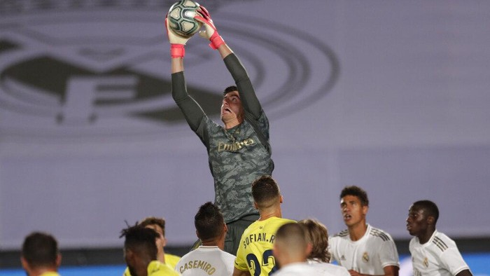 Real Madrids goalkeeper Thibaut Courtois blocks the ball during the Spanish La Liga soccer match between Real Madrid and Villareal at the Alfredo di Stefano stadium in Madrid, Spain, Thursday, July 16, 2020. (AP Photo/Bernat Armangue)