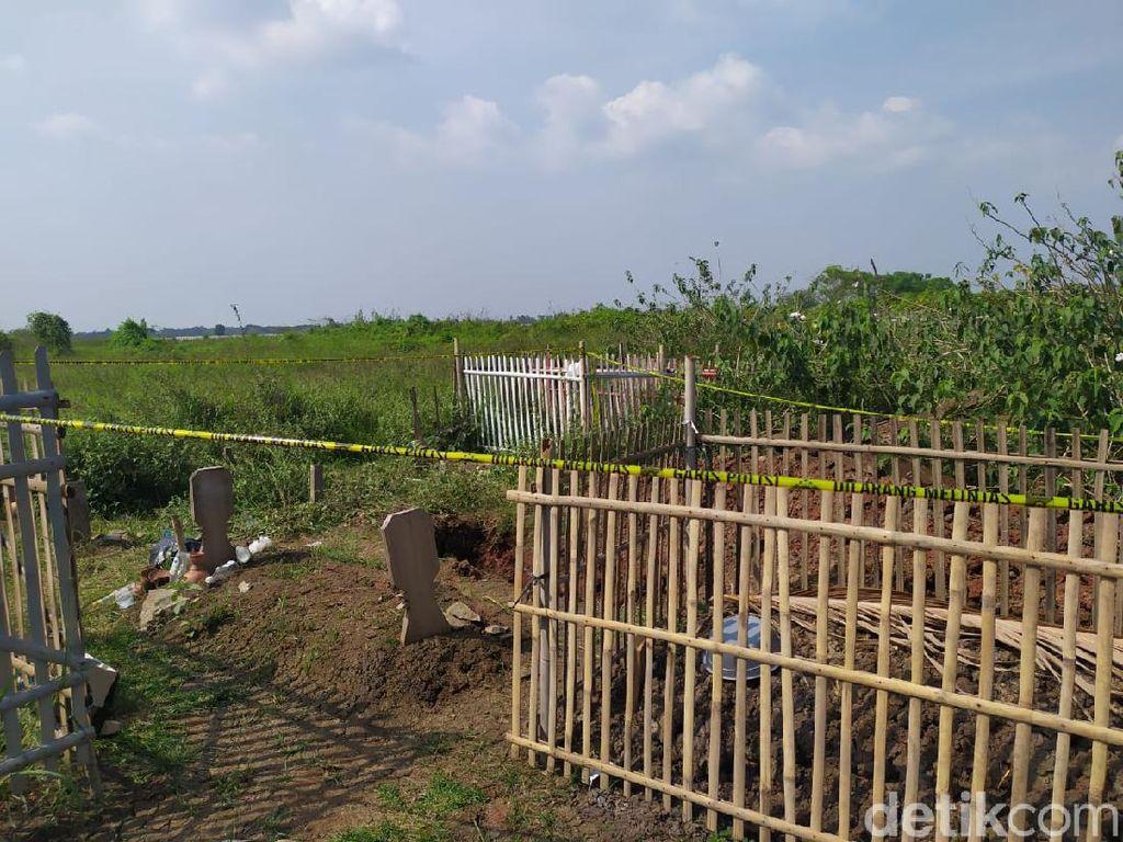 Olah TKP Makam Dibongkar di Bekasi, Polisi Kumpulkan Bukti Rambut-Tali Pocong