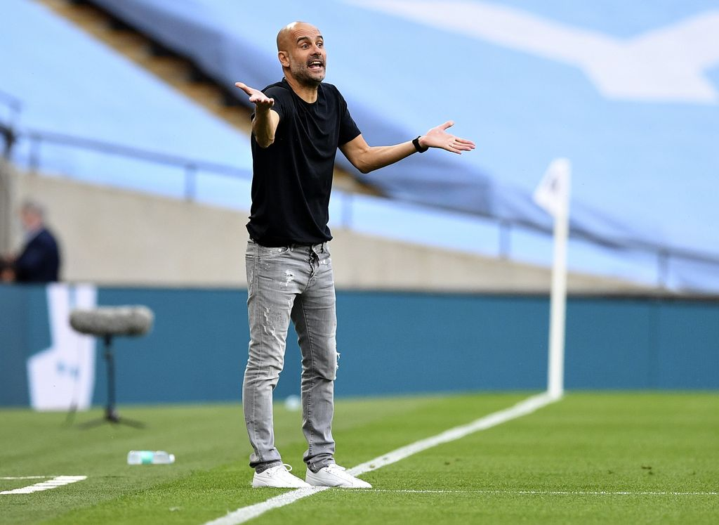 Manchester City's head coach Pep Guardiola gestures during the FA Cup semifinal soccer match between Arsenal and Manchester City at Wembley in London, England, Saturday, July 18, 2020. (AP Photo/Justin Tallis,Pool)