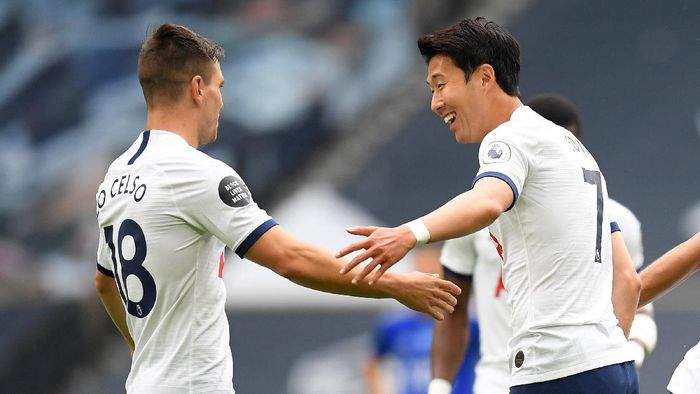LONDON, ENGLAND - JULY 19: Heung-Min Son of Tottenham Hotspur celebrates after he scores his sides first goal during the Premier League match between Tottenham Hotspur and Leicester City at Tottenham Hotspur Stadium on July 19, 2020 in London, England. Football Stadiums around Europe remain empty due to the Coronavirus Pandemic as Government social distancing laws prohibit fans inside venues resulting in all fixtures being played behind closed doors. (Photo by Michael Regan/Getty Images)