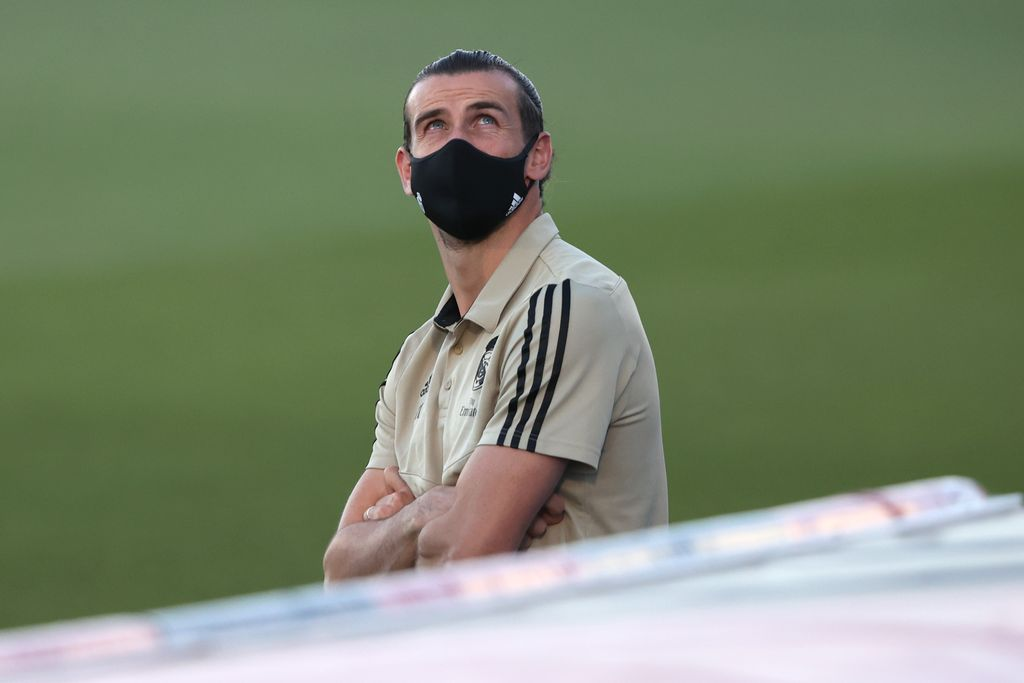 MADRID, SPAIN - JULY 02: Gareth Bale of Real Madrid wears a face mask prior to the Liga match between Real Madrid CF and Getafe CF at Estadio Alfredo Di Stefano on July 02, 2020 in Madrid, Spain. Football Stadiums around Europe remain empty due to the Coronavirus Pandemic as Government social distancing laws prohibit fans inside venues resulting in all fixtures being played behind closed doors. (Photo by Angel Martinez/Getty Images)