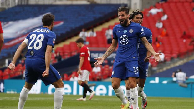 Chelsea's Olivier Giroud celebrates scoring the opening goal during the English FA Cup semifinal soccer match between Chelsea and Manchester United at Wembley Stadium in London, England, Sunday, July 19, 2020. (AP Photo/Alastair Grant, Pool)