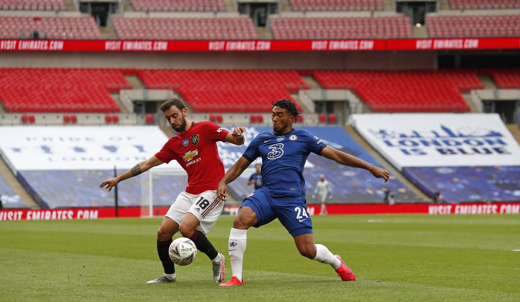 Manchester United's Bruno Fernandes, left, and Chelsea's Reece James battle for the ball during the English FA Cup semifinal soccer match between Chelsea and Manchester United at Wembley Stadium in London, England, Sunday, July 19, 2020. (AP Photo/Alastair Grant, Pool)
