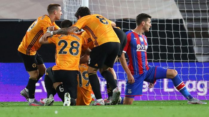 WOLVERHAMPTON, ENGLAND - JULY 20: Jonny Otto of Wolverhampton Wanderers (hidden) celebrates with teammates after scoring his teams second goal during the Premier League match between Wolverhampton Wanderers and Crystal Palace at Molineux on July 20, 2020 in Wolverhampton, England. Football Stadiums around Europe remain empty due to the Coronavirus Pandemic as Government social distancing laws prohibit fans inside venues resulting in all fixtures being played behind closed doors. (Photo by Catherine Ivill/Getty Images)