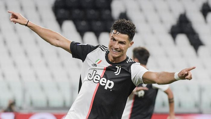 Juventus Cristiano Ronaldo celebrates after scoring during the Italian Serie A soccer match between Juventus and Lazio at the Allianz stadium in Turin, Italy, Monday, July 20, 2020. (Marco Alpozzi/LaPresse via AP)
