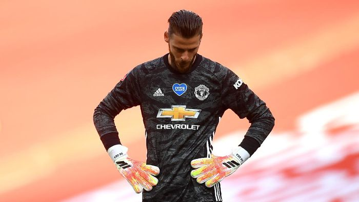 LONDON, ENGLAND - JULY 19: David De Gea of Manchester United reacts during the FA Cup Semi Final match between Manchester United and Chelsea at Wembley Stadium on July 19, 2020 in London, England. Football Stadiums around Europe remain empty due to the Coronavirus Pandemic as Government social distancing laws prohibit fans inside venues resulting in all fixtures being played behind closed doors. (Photo by Andy Rain/Pool via Getty Images)