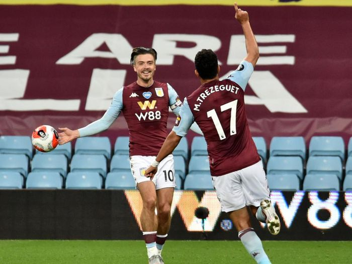 BIRMINGHAM, ENGLAND - JULY 21: Trezeguet of Aston Villa celebrates after he scores his sides 1st goal during the Premier League match between Aston Villa and Arsenal FC at Villa Park on July 21, 2020 in Birmingham, England. Football Stadiums around Europe remain empty due to the Coronavirus Pandemic as Government social distancing laws prohibit fans inside venues resulting in all fixtures being played behind closed doors. (Photo by Rui Vieira/Pool via Getty Images)