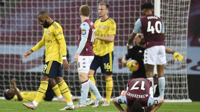 BIRMINGHAM, ENGLAND - JULY 21: Trezeguet of Aston Villa celebrates at the full time whistle during the Premier League match between Aston Villa and Arsenal FC at Villa Park on July 21, 2020 in Birmingham, England. Football Stadiums around Europe remain empty due to the Coronavirus Pandemic as Government social distancing laws prohibit fans inside venues resulting in all fixtures being played behind closed doors. (Photo by Peter Powell/Pool via Getty Images)