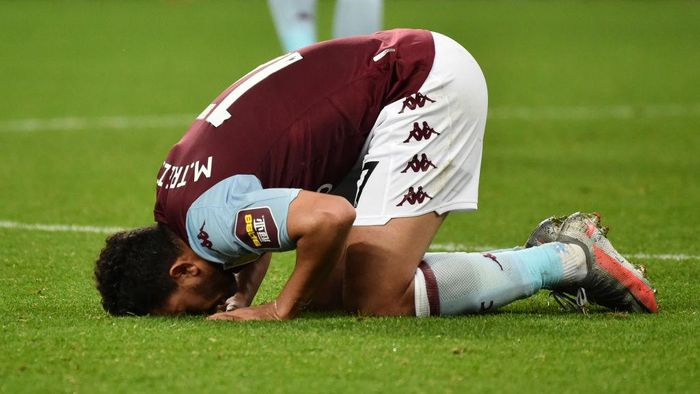 BIRMINGHAM, ENGLAND - JULY 21: Trezeguet of Aston Villa kisses the pitch after the Premier League match between Aston Villa and Arsenal FC at Villa Park on July 21, 2020 in Birmingham, England. Football Stadiums around Europe remain empty due to the Coronavirus Pandemic as Government social distancing laws prohibit fans inside venues resulting in all fixtures being played behind closed doors. (Photo by Rui Vieira/Pool via Getty Images)