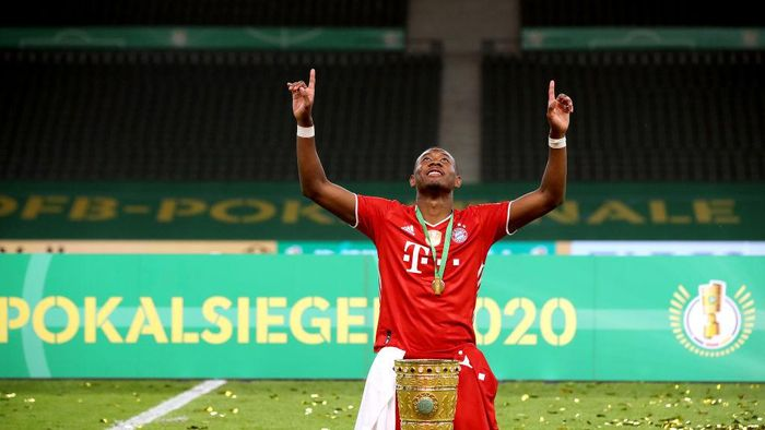 BERLIN, GERMANY - JULY 04:  David Alaba of FC Bayern Muenchen poses with the trophy in celebration after the DFB Cup final match between Bayer 04 Leverkusen and FC Bayern Muenchen at Olympiastadion on July 04, 2020 in Berlin, Germany. (Photo by Alexander Hassenstein/Getty Images)