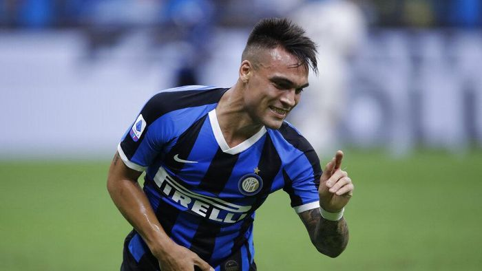 Inter Milans Lautaro Martinez gestures during a Serie A soccer match between Inter Milan and Fiorentina, at the San Siro stadium in Milan, Italy, Wednesday, July 22, 2020. (AP Photo/Luca Bruno)