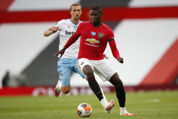 Manchester Uniteds Paul Pogba, center, fights for the ball with West Hams Tomas Soucek during the English Premier League soccer match between Manchester United and West Ham at the Old Trafford stadium in Manchester, England, Wednesday, July 22, 2020. (Clive Brunskill/Pool via AP)