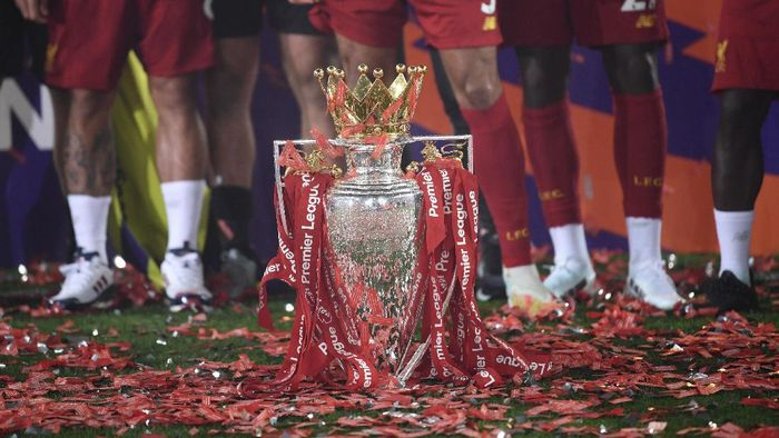 The English Premier League trophy is placed on the pitch after it was presented to Liverpool following the Premier League soccer match between Liverpool and Chelsea at Anfield stadium in Liverpool, England, Wednesday, July 22, 2020. (Paul Ellis, Pool via AP)