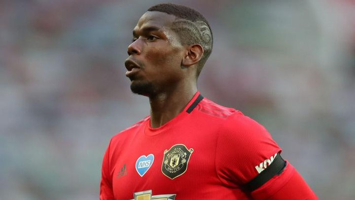 MANCHESTER, ENGLAND - JULY 22: Paul Pogba of Manchester United in action during the Premier League match between Manchester United and West Ham United at Old Trafford on July 22, 2020 in Manchester, England. Football Stadiums around Europe remain empty due to the Coronavirus Pandemic as Government social distancing laws prohibit fans inside venues resulting in all fixtures being played behind closed doors. (Photo by Catherine Ivill/Getty Images)