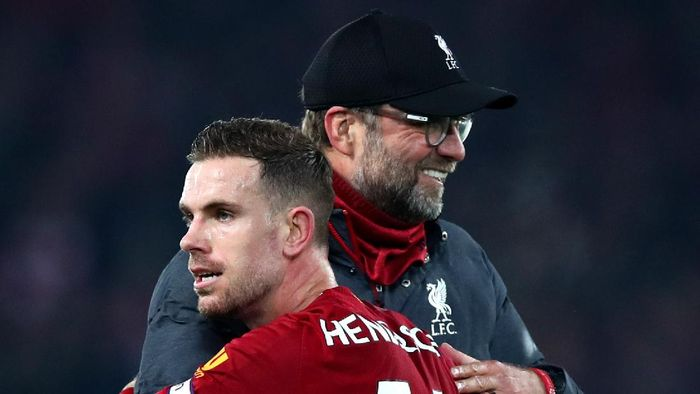 LIVERPOOL, ENGLAND - DECEMBER 29: Jurgen Klopp, Manager of Liverpool and Jordan Henderson of Liverpool during the Premier League match between Liverpool FC and Wolverhampton Wanderers at Anfield on December 29, 2019 in Liverpool, United Kingdom. (Photo by Clive Brunskill/Getty Images)