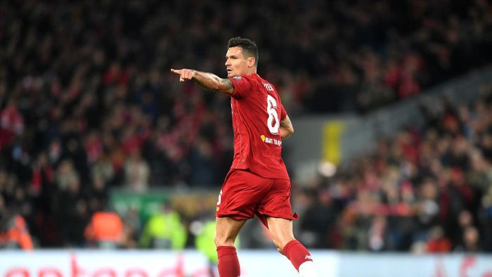 LIVERPOOL, ENGLAND - NOVEMBER 27: Dejan Lovren of Liverpool celebrates after scoring his teams first goal during the UEFA Champions League group E match between Liverpool FC and SSC Napoli at Anfield on November 27, 2019 in Liverpool, United Kingdom. (Photo by Michael Regan/Getty Images)