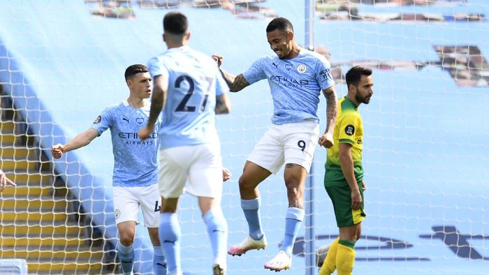 MANCHESTER, ENGLAND - JULY 26: Gabriel Jesus of Manchester City celebrates after scoring the opening goal during the Premier League match between Manchester City and Norwich City at Etihad Stadium on July 26, 2020 in Manchester, England.Football Stadiums around Europe remain empty due to the Coronavirus Pandemic as Government social distancing laws prohibit fans inside venues resulting in all fixtures being played behind closed doors. (Photo by Peter Powell/Pool via Getty Images)