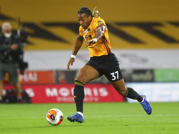 Wolverhampton Wanderers Adama Traore runs with the ball during the English Premier League soccer match between Wolverhampton Wanderers and Crystal Palace at Molineux Stadium in Wolverhampton, England, Monday, July 20, 2020. (AP Photo/Richard Heathcote,Pool)