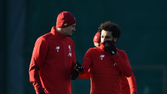 LIVERPOOL, ENGLAND - DECEMBER 09: Mohamed Salah of Liverpool (R) and Dejan Lovren of Liverpool (L) speak during a training session ahead of their UEFA Champions League Group E match against RB Salzburg at Melwood Training Ground on December 09, 2019 in Liverpool, England. (Photo by Nathan Stirk/Getty Images)