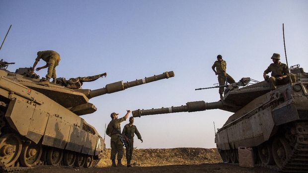 Israeli soldiers work on tanks in the Israeli controlled Golan Heights near the border with Syria, not far from Lebanon border, Tuesday, July 28, 2020. Lebanon's prime minister has accused Israel of provoking a