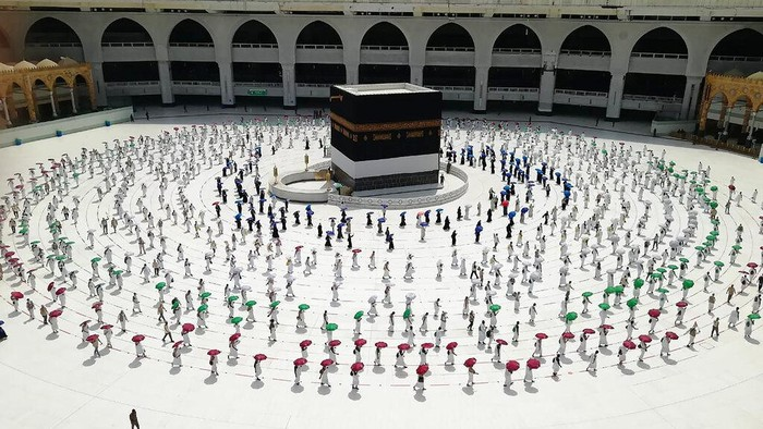 Muslim pilgrims line up as they leave after they circle the Kaaba, the cubic building at the Grand Mosque, as they keep social destination to protect themselves against Coronavirus a ahead of the Hajj pilgrimage in the Muslim holy city of Mecca, Saudi Arabia, Wednesday, July 29, 2020. During the first rites of hajj, Muslims circle the Kaaba counter-clockwise seven times while reciting supplications to God, then walk between two hills where Ibrahim's wife, Hagar, is believed to have run as she searched for water for her dying son before God brought forth a well that runs to this day. (AP Photo)