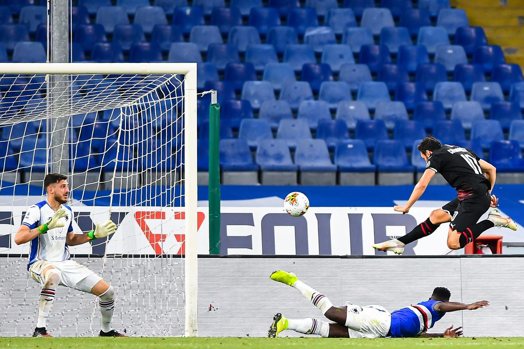 GENOA, ITALY - JULY 29: Hakan Calhanoglu of Milan (R) scores a goal during the Serie A match between UC Sampdoria and AC Milan at Stadio Luigi Ferraris on July 29, 2020 in Genoa, Italy. (Photo by Paolo Rattini/Getty Images)