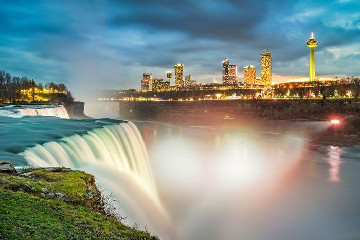 American side of Niagara falls, NY, USA. Tourists enjoying beautiful view to Niagara Falls during hot sunny summer day.