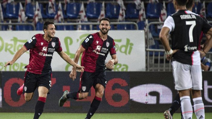 Cagliaris Luca Gagliano, left, celebrates after scoring during the Serie A soccer match between Cagliari and Juventus, at the Sardegna Arena stadium, in Cagliari, Italy, Wednesday, July 29, 2020. (Alessandro Tocco/Lapresse via AP)